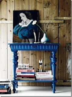 blue painted table and artwork