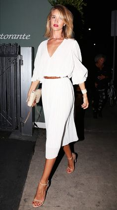 Rosie Huntington-Whiteley belts a white crepe dress and finishes the look with nude accessories