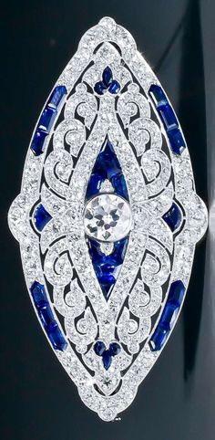 An Art Deco sapphire and diamond brooch, by Mauboussin Paris, circa 1924. Set throughout with old European- and single-cut diamonds, and calibré-cut sapphires. The openwork platinum mount shows the typical 'millegrains' finish. Unsigned. Accompanied by th