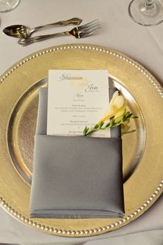 totally our color theme!! I think i want the napkins draping over the table though, but im glad to see that the gold/gray go well with eachother with a white table cloth