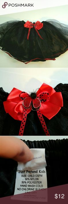Super cute lady bug tutu skirt Lady bug tutu-Like skirt from Just Pretend Kids Black glittery shell with red ribbon accents, with elastic waistband fits 18m-4t Can be used for casual dress up, Halloween or just running errands with mom.  Adorable! No stains or tears From a smoke and pet free home  A56 just pretend kids Bottoms Skirts