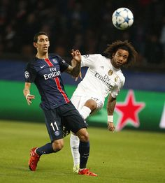 Angel Di Maria of PSG and Marcelo of Real Madrid in action during the UEFA Champions League match between Paris SaintGermain and Real Madrid at Parc...