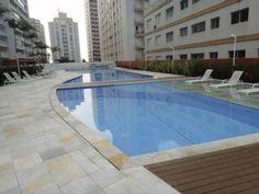 Apartamento Temporada em Astúrias: Apto. NOVO, 30 mts da praia, lazer completo, terraço c/ churrasq., 2 VGS DE GAR.