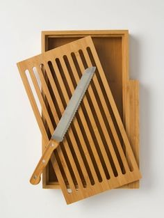 Bamboo Bread Board Set: the crumbs fall through the slats and the knife gets stored on the side. Knife Storage, Wood Worker, Bread Board, Woodworking Projects Plans, Furniture Plans, Table Furniture, Kitchen Items, Cool Kitchens, Wood Crafts
