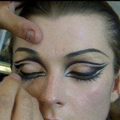 This method of eye makeup would make the eyes look bigger from a distances, great on the competition floor for ballroom. Visit http://ballroomguide.com/comp/hair_make_up.html for more hair and makeup info