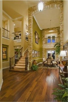 My home will be open like this. Tall ceilings with wood and stone accents. The color works perfectly as well... I am pretty much set that this will be my future home.