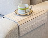 Sofa Tray Table from LipLap on Etsy (though one might even be able to use wooden bamboo placemats for a similar use - though not quite as stable).
