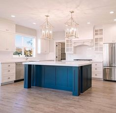 All white cabinets and teal island