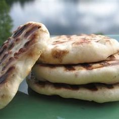Naan - Allrecipes.com.   Very easy to make and VERY TASTY!   All who have tried want to know when I an making it again.