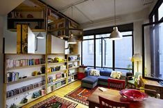 The adorably named UnWaste Bookcase is a full-wall, rotating library by architect Ben Milbourne (Bild Architecture), eco-designer Leyla Acaroglu (Eco Innovators) and furniture designer David Waterworth (Against the Grain). It's constructed from reclaimed plywood collected from construction sites. Walls of books that spin? Yes, please!