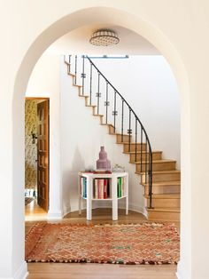 arched entryway doorway // curved staircase