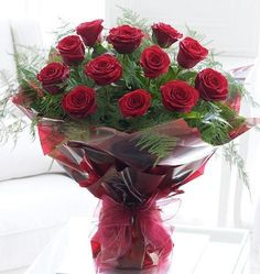Aren't they gorgeous?! A beautiful bouquet including 12 red roses.