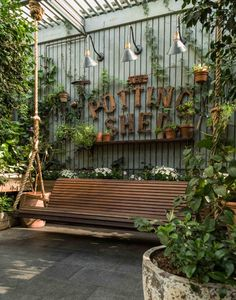 The Potting Shed: A Green Oasis in Alexandria This restaurant in Alexandria, Australia, is a green oasis. Plants adorn every wall and nook while beautiful reclaimed wood furniture makes for a cozy interior.The Potting Shed doesn't only serve a Restaurant En Plein Air, Outdoor Restaurant, Greenhouse Restaurant, Coffee Shop Design, Cafe Design, Bistro Design, Deck Design, Garden Coffee, Reclaimed Wood Furniture