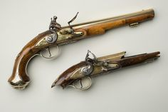 "George Washington's correspondence includes dozens of references to purchasing pistols & receiving them as gifts from friends.His executors recorded 4 pairs of pistols & ""7 Guns"" in his Study after his death.All these were either imported from England or crafted from parts made there,as few gunsmiths in 18th-century America.This pair of flintlock holster or traveling pistols survived in good condition until the mid-19th century,when family history maintains a curious servant fired one."