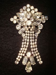 1930s art deco waterfall rhinestone brooch.