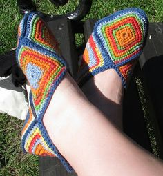 Awesome granny square slippers pattern from Välkommen till virkpia.  It's in Swedish by with the translator you can kind of tell what's happening and there is a great diagram.