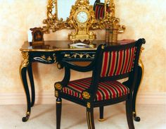 Add glamour and European styling with our Louis Bureau Plat, shown here as an example, finished in Ebony and 24 carat gold leaf. Perfect for a bedroom, grand office, living space or hall. Complete with a Louis style armchair upholstered in silk or brocade and chandelier lighting. Features      Louis Bureau Plat is made from kiln dried mahogany. Available in a choice of a painted finish, antiqued paint finish or antiqued paint finish with gilding.     NB: Image shows Ebony finish with 24ct…