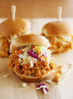 Slow Cooker Buffalo Chicken Sliders - Serve this tangy, tender slow cooked buffalo chicken on buttery toasted buns, or as lettuce wraps! Thecomfortofcooking.com