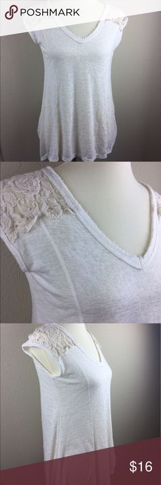 Bobeau White Top with Lace Cap Sleeves Bobeau white semi sheer top with cream colored lace cap sleeves.  The collar and neckline have a raw finish. It is a soft knit with a v neck, and it is great condition. bobeau Tops Blouses