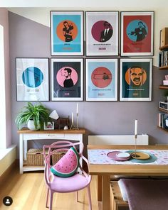 A colourful, modern living room in a London flat. Eclectic mix of furniture; a modern pink Masters chair sits with a traditional wooden table and sideboard. There is a feature wall of alternative movie posters. Wall Film, Room Posters, Movie Posters, Home And Deco, Living Room Art, Bedroom Wall, Decoration, Wall Decor, Gallery Walls