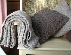 Google Image Result for http://assets2.notonthehighstreet.com/system/product_images/images/000/023/053/original_cable_knit_throw.jpg%3F1335116049