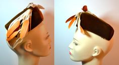 What a gorgeous 1950s vintage velvet pillbox hat by Miss Bette. This 1950s pillbox hat has the back opening to sit nicely on your head, has two combs to secure the hat and has a lovely floral lining. In a pretty brown with a slight orange hue velvet. Giving it added glamour are the ivory satin strands with orange and beige feathers. From Smartwear of Milwaukee and comes in the original hat box. In amazing condition! Hat measures as follows: Circumference approx: 13.5 (from edge to edge…