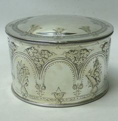 Antique Silver Plated Tea Caddy // A very pretty antique caddy box of oval form having a hinged lid. With bead borders and deep embossed decoration of flowers and leaves. Height 9 cms. Top 14 x 11 cms. Marked underneath with Elkington silver plate stamps and date code for 1867. SOLD //  - Maria Elena Garcia -  ► www.pinterest.com/megardel/ ◀︎