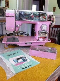 Bling Bling vintage 50's Original PINK sewing machine made by Toyota in Japan. It's the pink cadillac of sewing machines.RARE