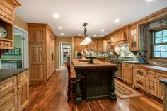 Charming 4BR, 4.5BA home in exceptional Academy Est. Assoc w/tranferable boat slip, Renovated gourmet kitchen. Pool, quality bball court, gazebo, on lovely wooded lot. Beautiful hardwood floors, additional lower level kitchen, walkout to pool, High quality home offers lots of spaces to gather and entertain family and friends.