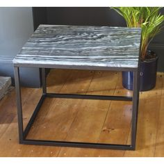 Grey Marble and Iron Coffee Table by House Doctor DK - A Nordically designed coffee table that features a high quality marble surface in a versatile and refined grey. Placed upon a sturdy and minimal iron frame, this table exudes a contemporary yet timeless charm. Product Dimensions: 60 x 60 cm. Height: 46.5 cm