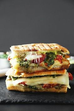 Grilled Chicken Pesto Panini is the ultimate lunch. Ciabatta bread stuffed with … Grilled Chicken Pesto Panini is the ultimate lunch. Ciabatta bread stuffed with grilled chicken, pesto, avocado aioli, cheese, and roasted tomatoes! Panini Sandwiches, Wrap Sandwiches, Healthy Sandwiches, Panini Sandwich Recipes, Healthy Lunch Wraps, Croissant Sandwich, Gourmet Sandwiches, Bacon Sandwich, Cuban Sandwich