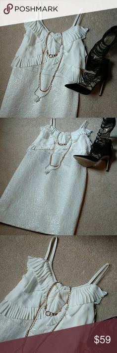 """*LOFT White/Metallic Cocktail Dress* *Great Condition!! Beautiful classy white/metallic cocktail dress perfect for the wedding season.   Textured Jacquard fabric on bottom. Classy Flowy ruffles on top. Kick pleat. Back zipper w/ clasp closure. Lined. Minor washable stain (see Pic. 6).   Length: 37.5"""", Pit-to-Pit: 18.5"""". Upper body: 100% Polyester. Lower body: 55% Cotton, 37% Polyester, 8% Metallic. Lining: 100% Polyester. Dry Clean. Ask any questions. Happy Poshing!!* LOFT Dresses Midi"""