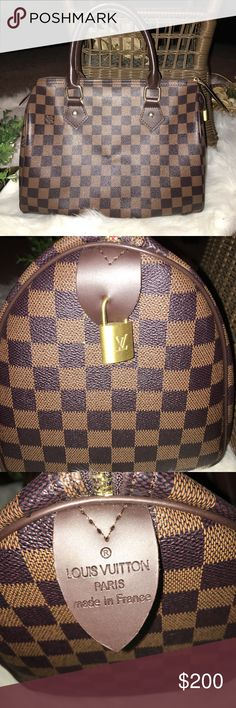 Beautiful Checkered Bag 👜 Don't ask the obvious 😉 Like new Speedy 30. Small stain on the inside which can be cleaned with soap and water. Comes with working lock and key 🔐. Soft to the touch and not plastic-like. Worn 3 times but I purchased an authentic Speedy 30 and I no longer need this one. I'm open to offers. NO LOW BALLS!! I'm not new to this 💜 Bags