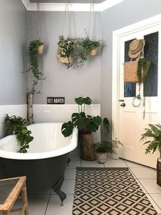 As we enter the era, we can't help but notice is ahead of the trends with a black bath & vintage plants Rustic Bathroom Vanities, Bathroom Red, Bathroom Plants, Boho Bathroom, Large Bathrooms, Bathroom Colors, Bathroom Styling, Small Bathroom, Bathroom Ideas