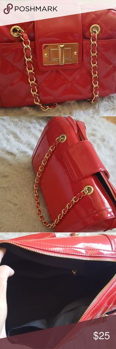 Purse Red glossy with gold chains straps and gold buckle a little scuff marks . Aldo Bags