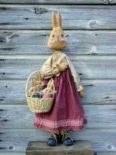 Momma bunny doll has her baby bunnies in a basket, so cute.