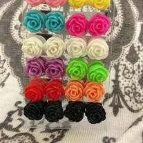Super cute and fun flower earrings! These are great for kids, teens or adults! Wear them year round! They also make great stocking stuffers. :)   Please make sure to choose your color.  Find me on facebook @ Island Belles  Find me on instagram @ Islandbelles