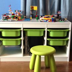 Ikea children's storage with plastic drawers. Glue Lego building base boards onto the top and fill the drawers with the Legos and you have a custom made Lego table!