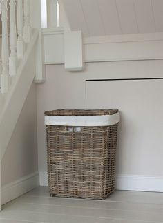 A Large square-shaped Laundry Basket in rattan with liner