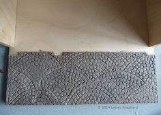 Paint a Surface to Resemble Miniature Cobblestone Pavers