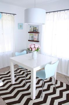 chevron rug, chairs, table, lamp.