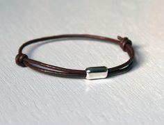 Leather bracelet. I had a bunch like this when I was younger.