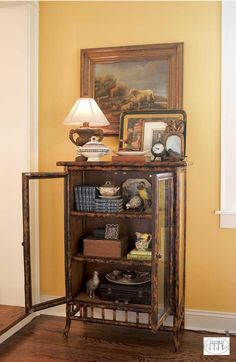 Turn a small wall in your living room into an arresting feature with a curious cabinet filled with treasures.