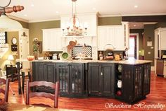 Like the black cabinets and the green wall color.  Ideas galore!