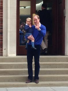 Prince George wave before going into St Mary's Hospital's Lindo Wing to meet his little sister, with his father Prince William.