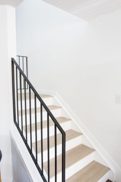 Modern Metal Railings + A Sleek Staircase Design Metal railings instantly elevate a staircase design! Check out the before and after of our modern metal makeover and why we went vertical! Black Stair Railing, Stair Railing Design, Stair Handrail, Staircase Railings, Spiral Staircases, Bannister, Staircase Ideas, Stairways, Wrought Iron Stairs