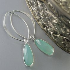 These earrings are simply stunning. Made with aqua blue chalcedony sterling silver bezels with large sterling silver marquise earring hooks. Wear these beauties with your favorite jeans, to work or fo