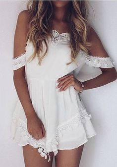 Front view of tanned woman wearing white cold shoulder lace trim romper