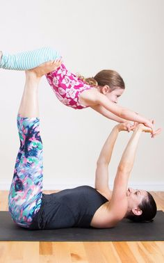 You love yoga. You love spending time with your children. So why not combine the two and do yoga together? These partner yoga poses are perfect for all ages; you'll just need to modify them depending on your child's ability and attention span. Have fun! Yoga Poses For Two, Partner Yoga Poses, Kids Yoga Poses, Easy Yoga Poses, Yoga Poses For Beginners, Yoga For Kids, Pilates Poses, Pilates Classes, Family Yoga