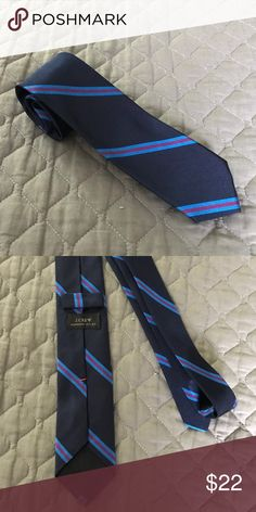 J.Crew Navy Silk Tie Like new condition only worn a few times! It is mostly navy with some blue and Fushia stripes. It's a skinny tie about 2.5 inches wide. Accessories Ties